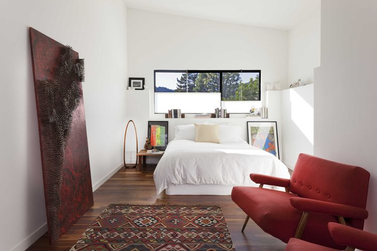 Midcentury renovated bedroom with red vintage chairs
