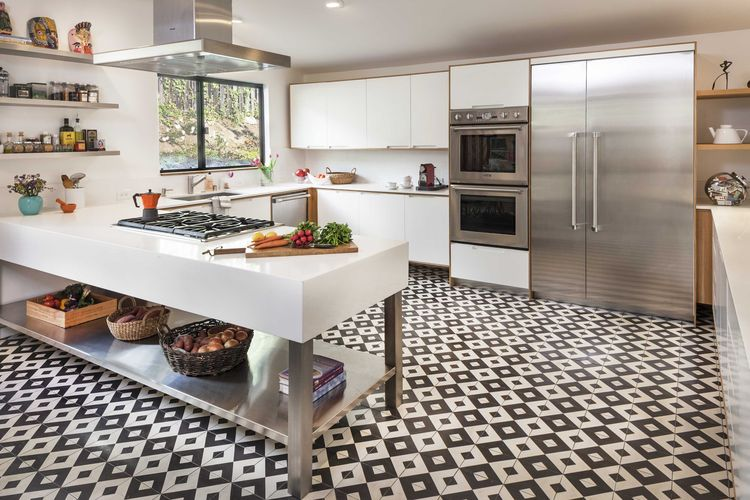 Renovated midcentury kitchen with black and white tile and Thermador appliances
