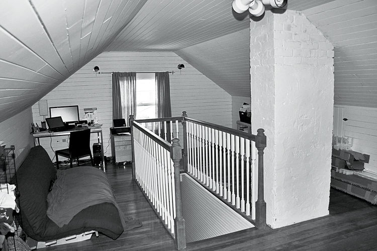 Prior to the renovation, the attic was cramped and poorly lit.