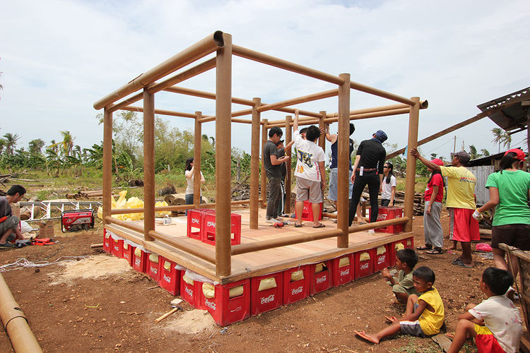 Students build typhoon shelters in the Philippines.