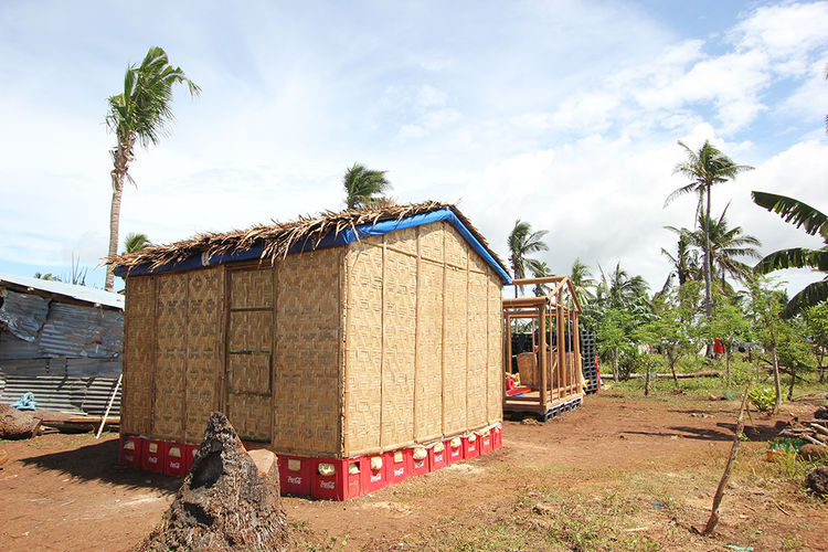 Soda crates form the foundation of these prefab shelters.