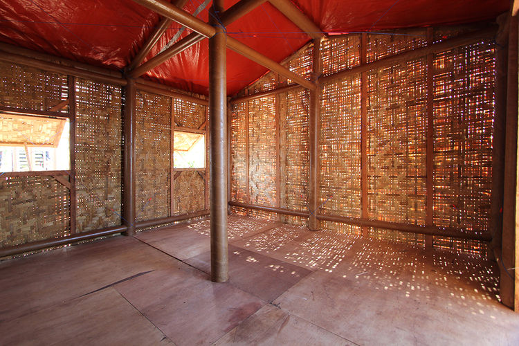 Woven-bamboo sliding allows light into the structure.