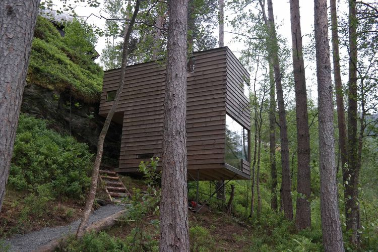 Juvet hotel in Norway with wood cabin on a hillside