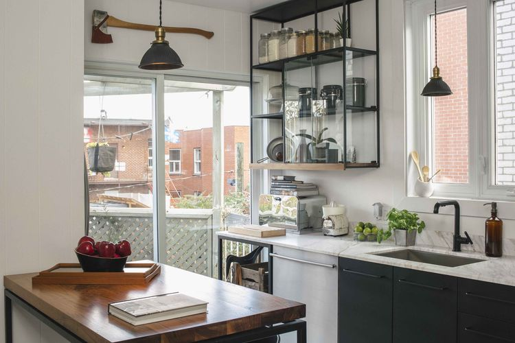 Montreal kitchen with glass windows and walnut table