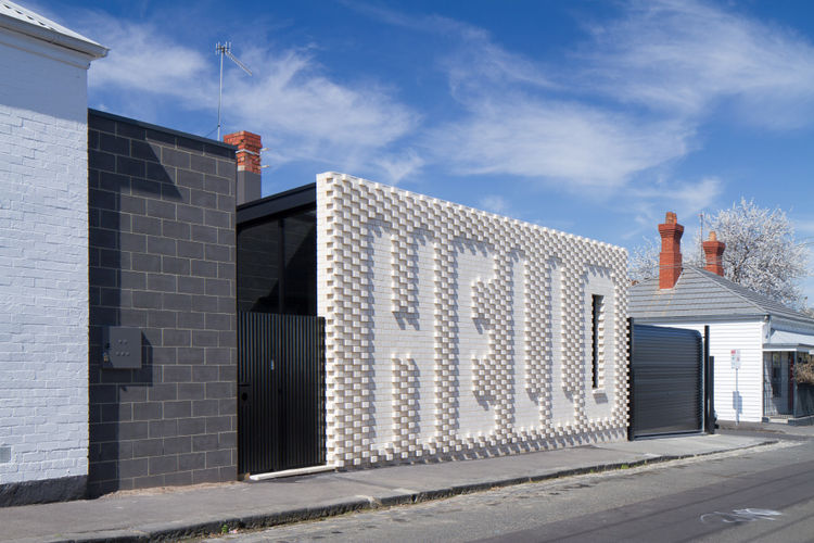 Hello house in Melbourne with white brick exterior