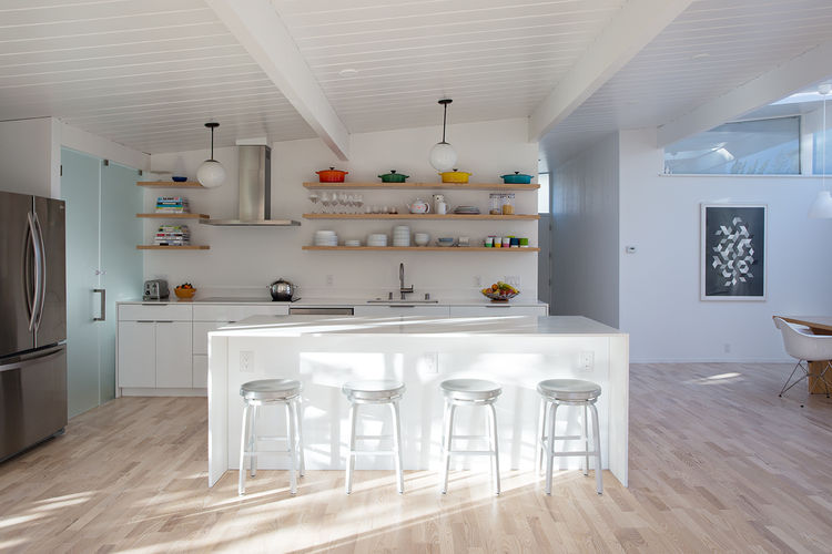Eichler kitchen remodel with white island and stools