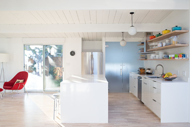 Eichler great room remodel with white kitchen