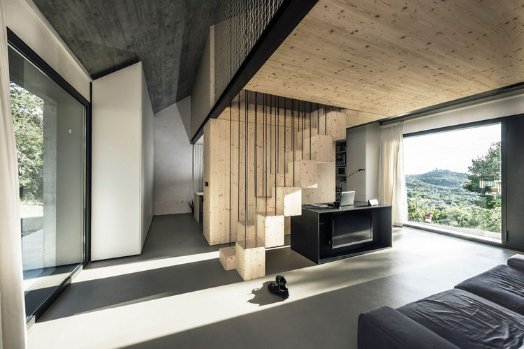 Stone house in Karst with minimal wood and concrete interior