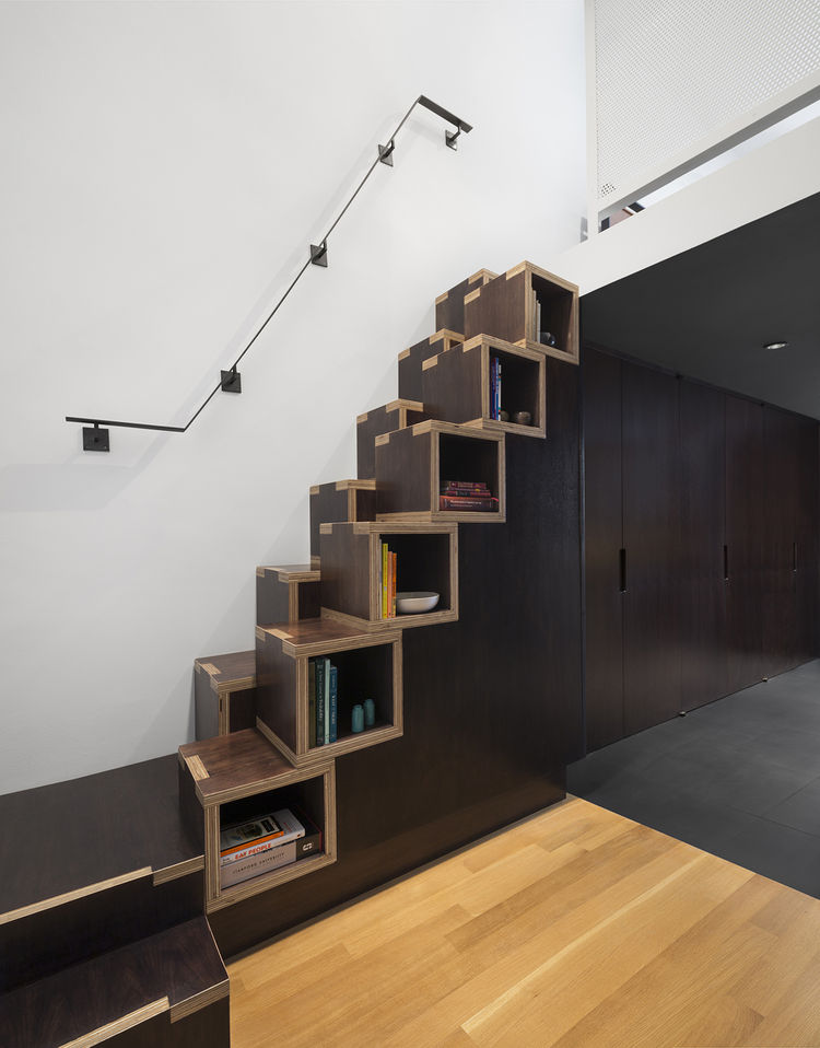 NYC apartment with staircase that doubles as a bookshelf