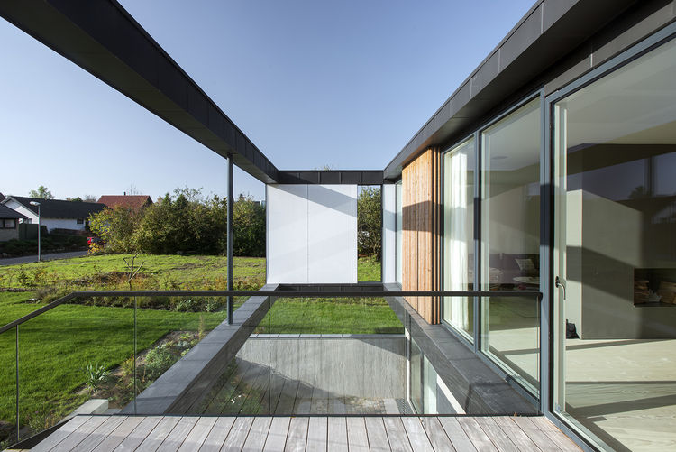 mimimalist house with glass walls