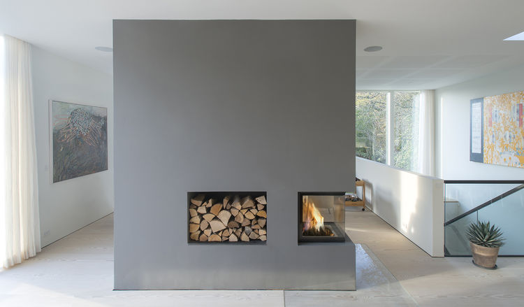 modern fireplace with wood storage