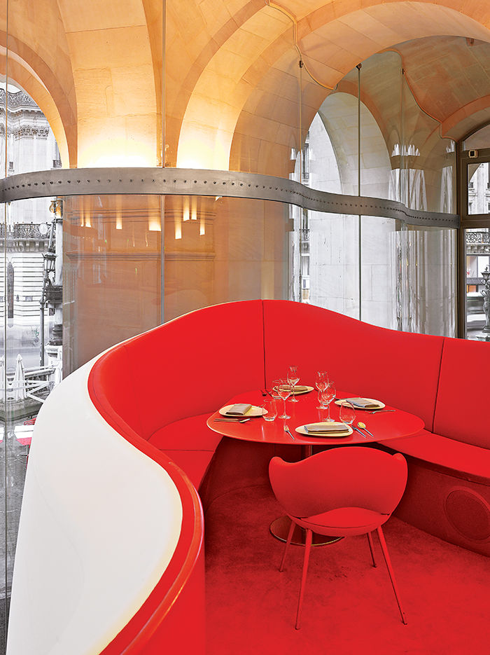 Red booth in Odile Decq's Phantom restaurant in Paris