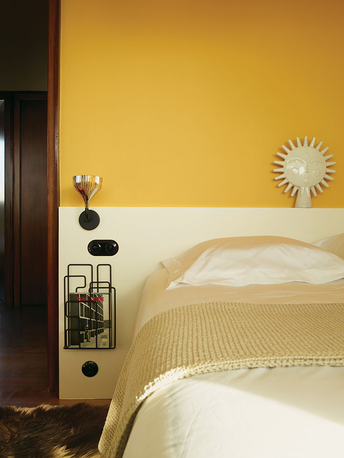 French bedroom with yellow walls