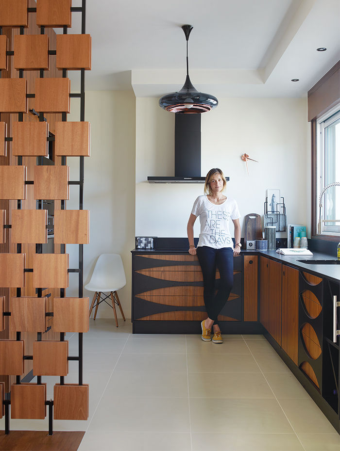 Interior designer Florence Deau in her modern kitchen filled with vintage finds in France