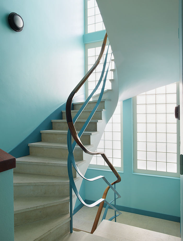 Winding staircase inside a modernist French apartment building