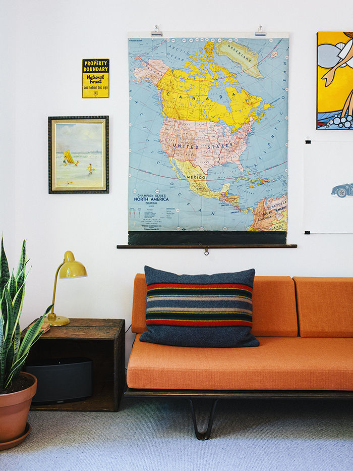 Orange Case Study daybed against white walls and artwork in midcentury house