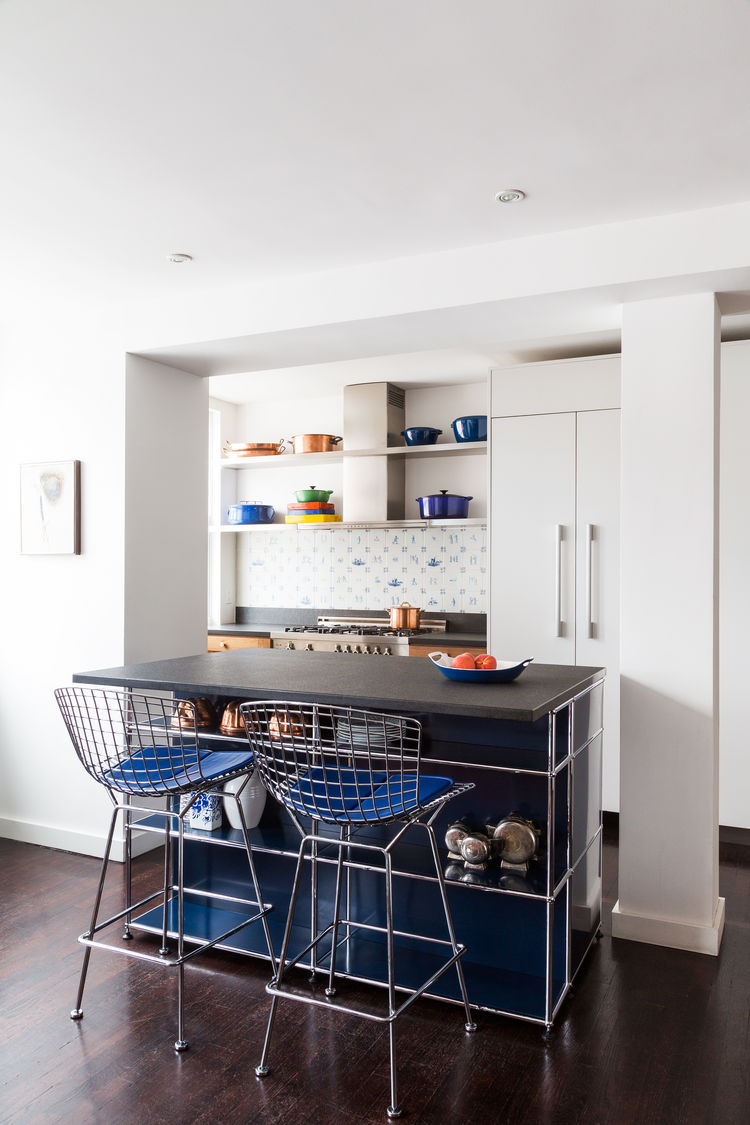 Meatpacking district condo with USM island and Bertoia stools