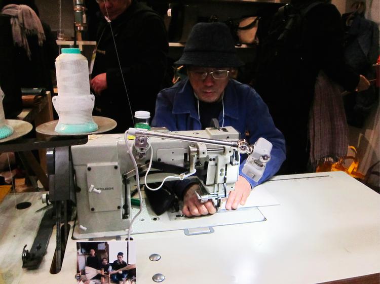 Hiroshi Matsuno sewing a bag at the Tokyo gift fair