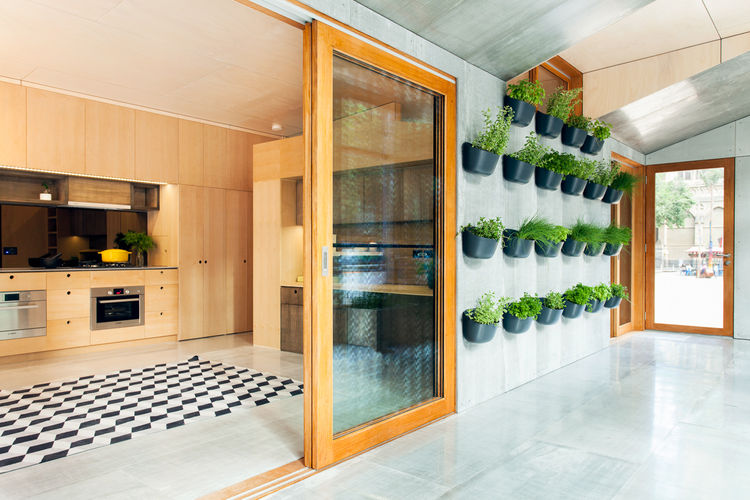 Carbon-positive prefab house with plants on the wall