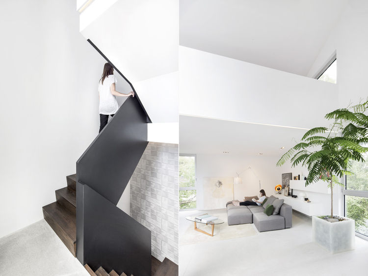modern black staircase and living room with gray sofa