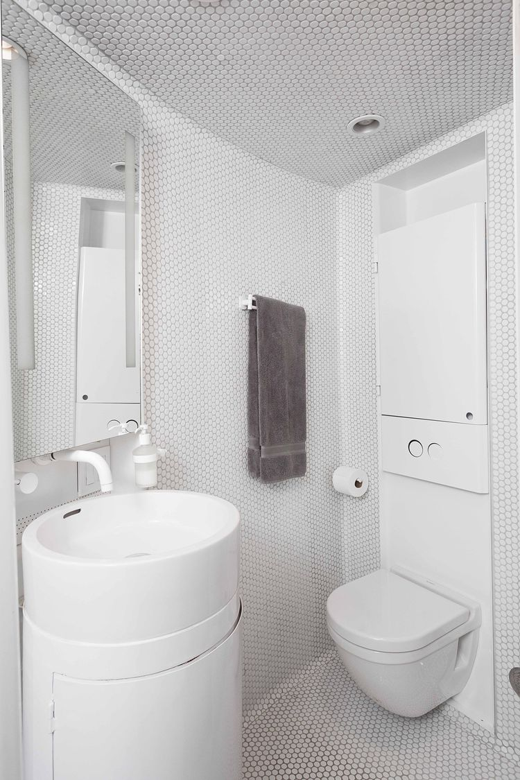 White bathroom in a converted grain silo