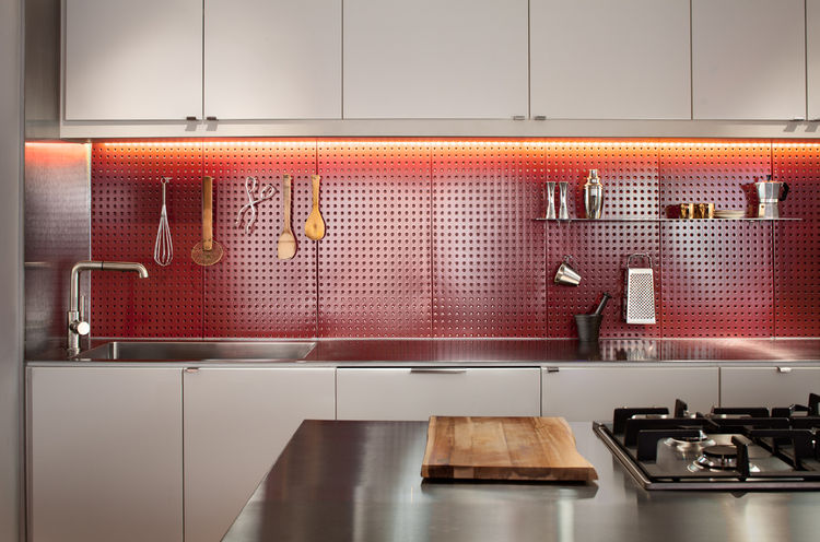 Kitchen with Ikea cabinets and red pegboard backsplash