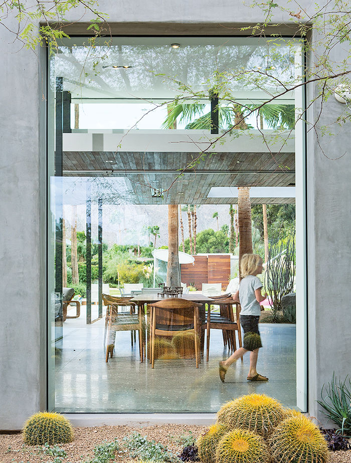 Floor to ceiling windows in dining area at Indian Summer home in Southern California