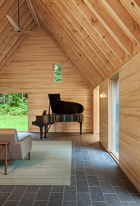 grand piano in a rustic cottage
