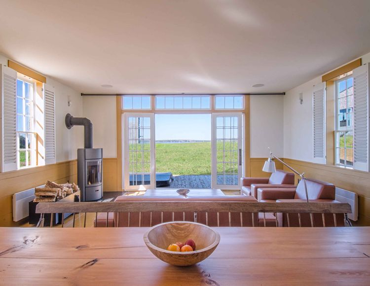 Chebogue Schoolhouse living room with window overlooking the ocean