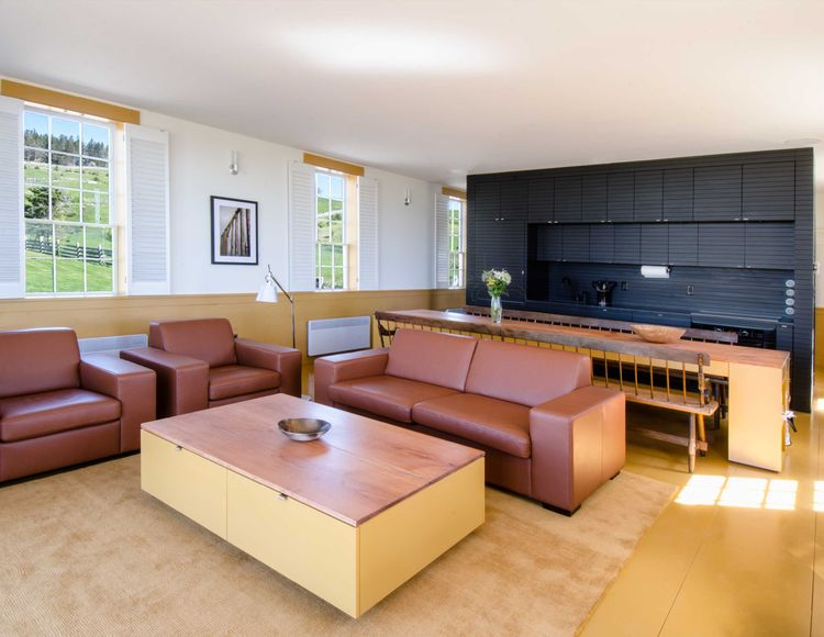 Chebogue Schoolhouse living room with black freestanding kitchen