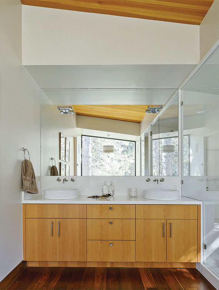 Master bathroom features chrome sconces.