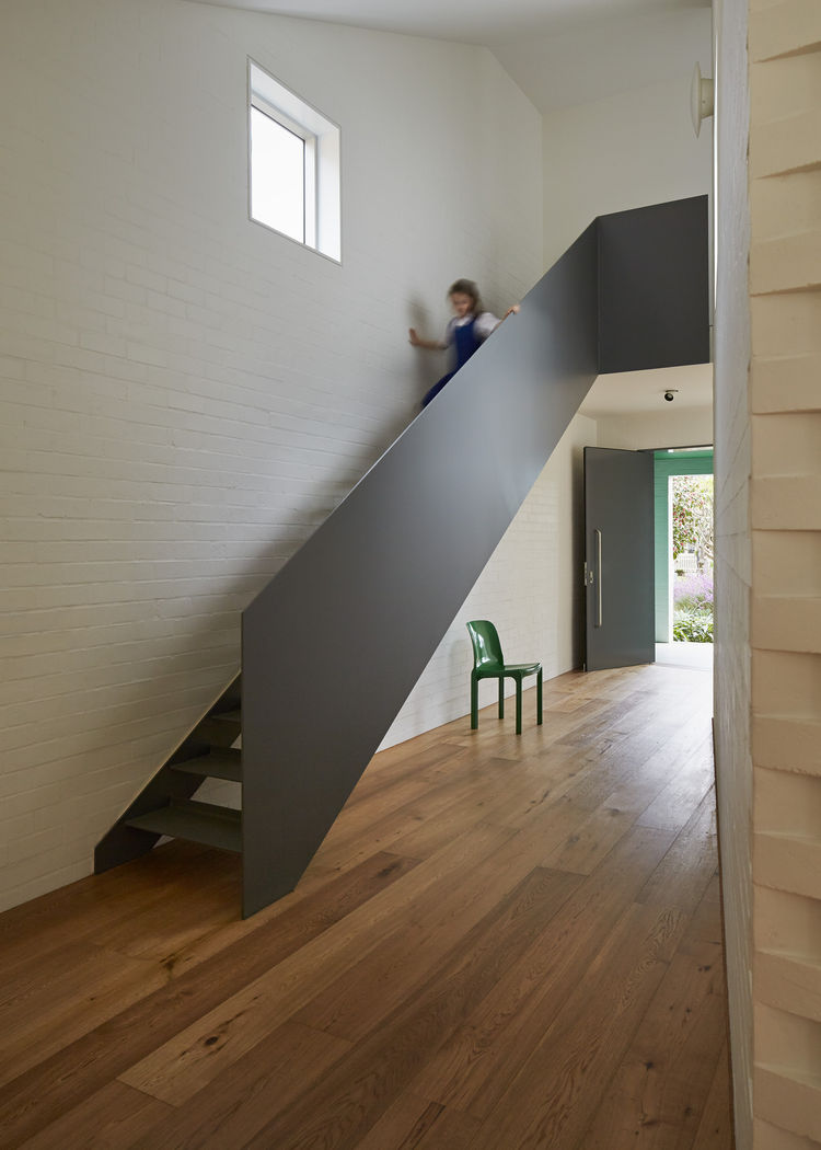 Steel staircase in a white brick home