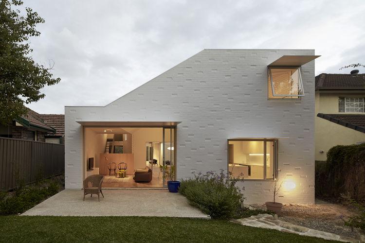 Angular brick house with steel shades on the windows