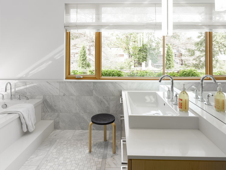 Carrara marble–clad bathroom in a modern house