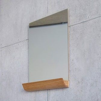 Innovative wall mirror with slim profile and convenient drawer