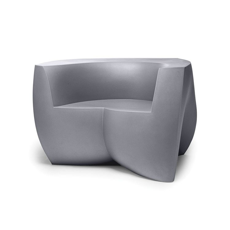 Sculptural outdoor easy chair in molded polymer
