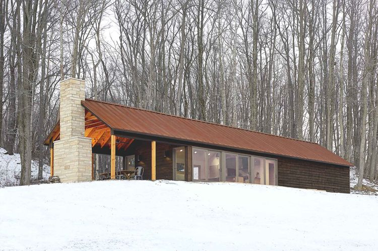 Off the grid retreat with floor-to-ceiling windows and insulated building envelop