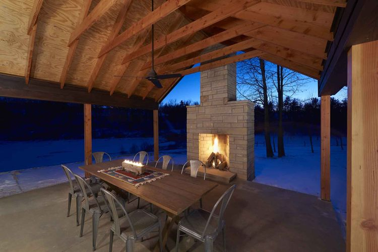 Off the grid retreat with outdoor dining area and fireplace