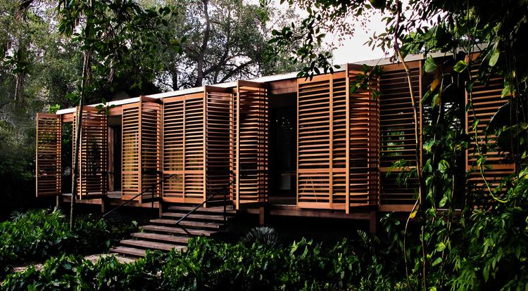 Midcentury Miami Home shuttered doors front exterior