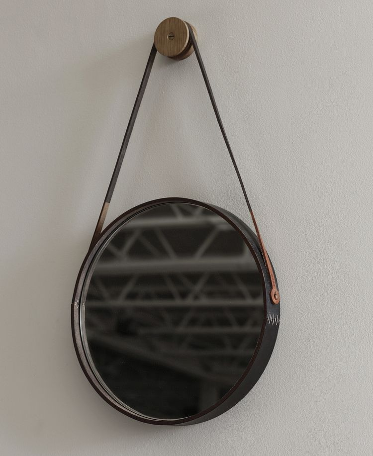 Distinctive captain's mirror with black and brown leather accents