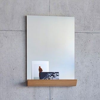 Rectangular mirror with curved wood storage shelf