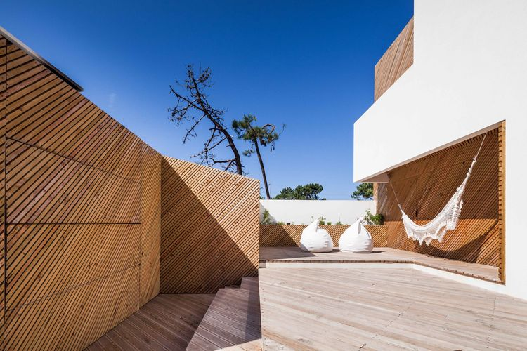 Portuguese beach house with diagonal wood slats