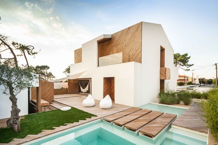 Portuguese beach house with stucco and silver wood