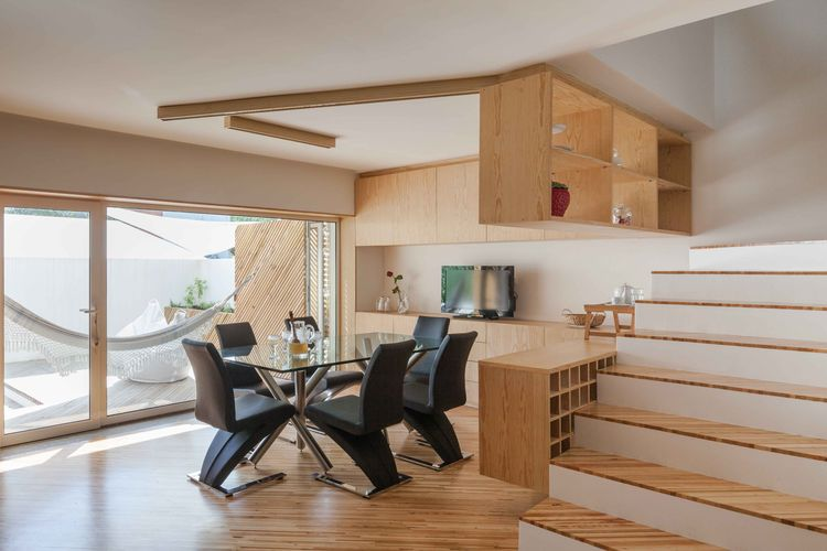 Portuguese beach house with wood cabinets, furniture, and flooring