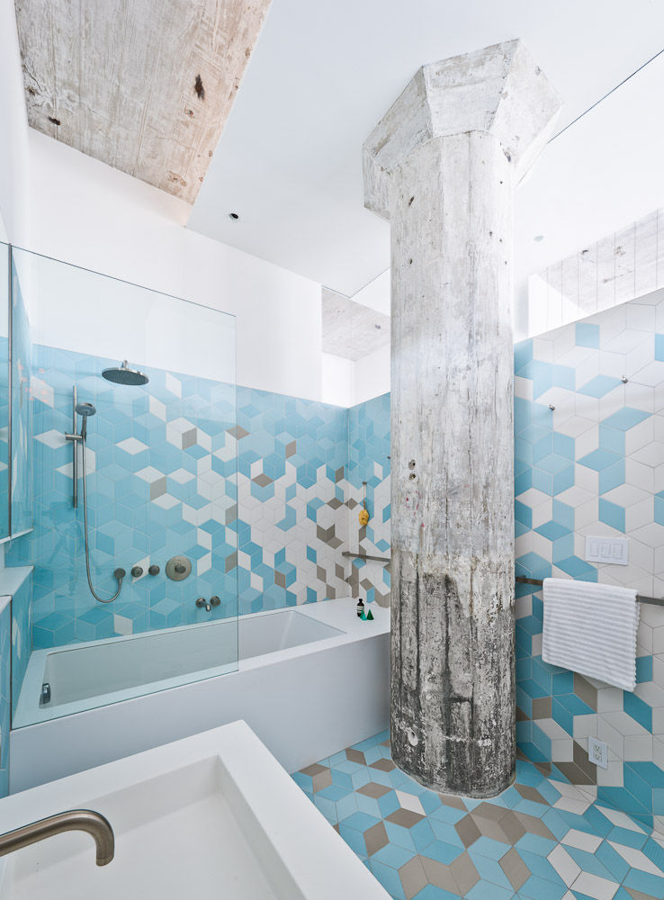 Exposed concrete column in a Brooklyn bathroom