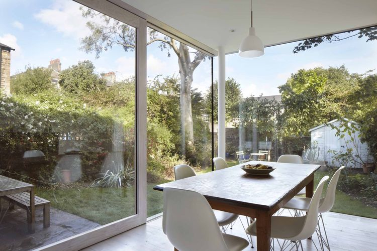 Vegetarian Cottage dining room with Eames chairs.