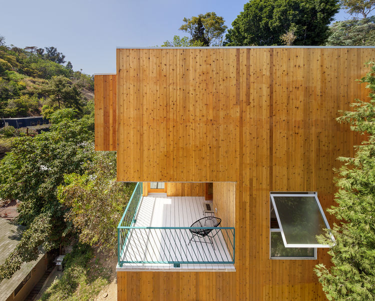 Covered balcony of the Brother and Sister homes by Anonymous Architects