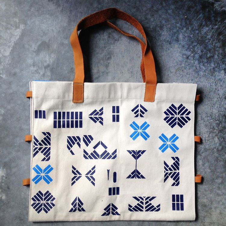 Graphic printed tote bag with soft leather accents