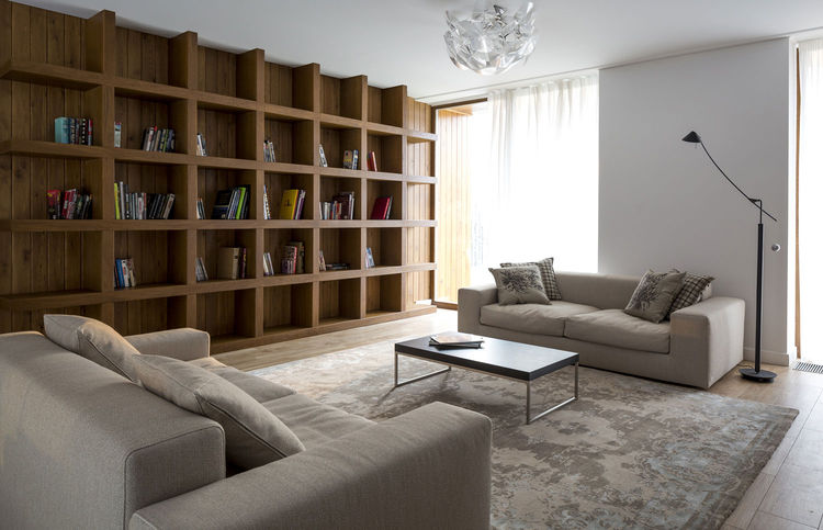 A living room with a built-in bookshelf