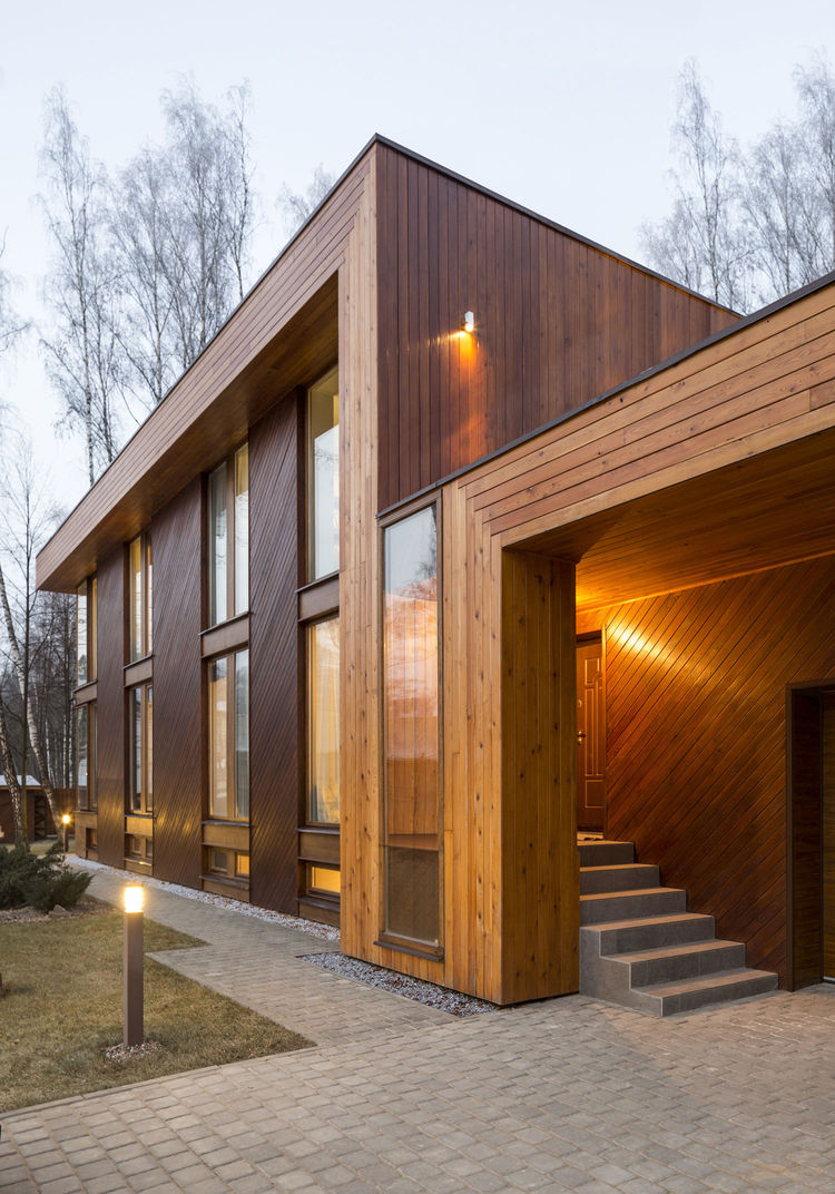 Russian house clad in larch timber planks